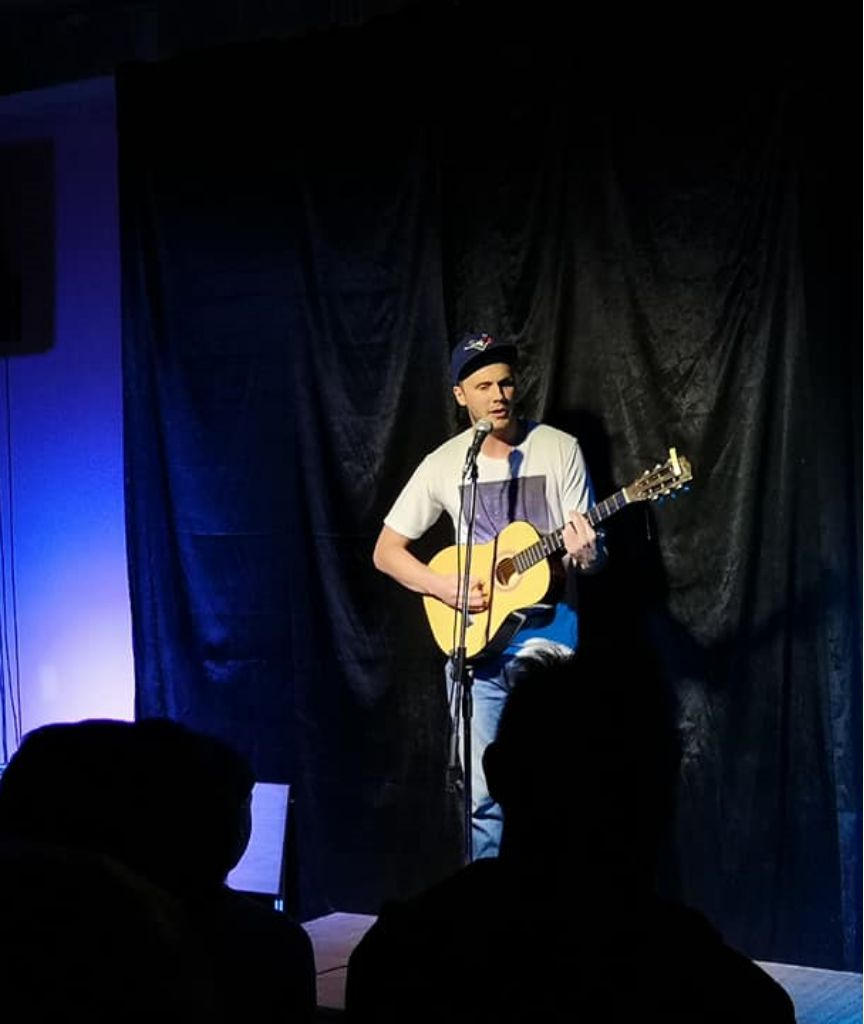 Stand up comedy with guitar